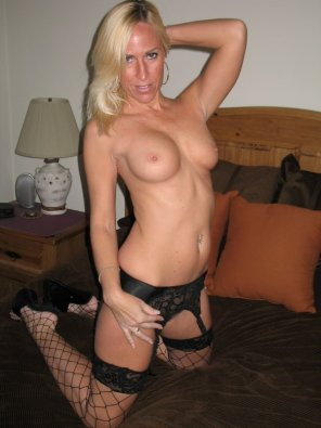 amateur photo Mature lady showing off her tits