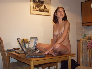 amateur photo Table sitter with a big laptop. Circa 2006 or so?