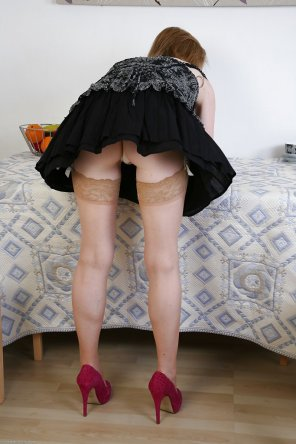 amateur photo bending over while in heels