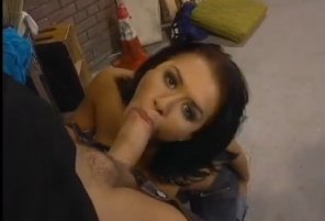 amateur photo Eva Angelina. Looks up like she is busy and has a job to do.