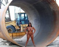 Curvy babe going nude at a construction site