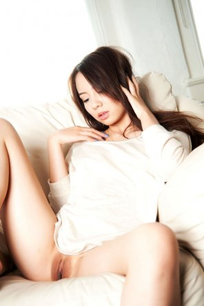 amateur photo Asian on a couch