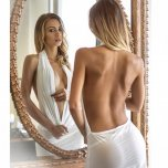 amateur photo Naked underneath her backless scoop mini-dress