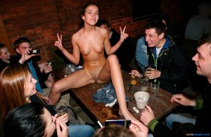 amateur photo Unashamed teen nude on table in front of friends at restaurant
