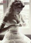 amateur photo Tying her corset