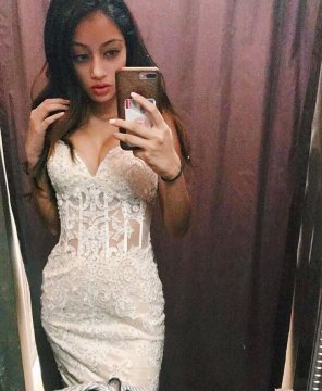 amateur photo Indian trying on dress