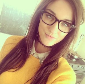 amateur photo yellow sweater and glasses