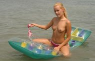 Babe takes her top off at the lake
