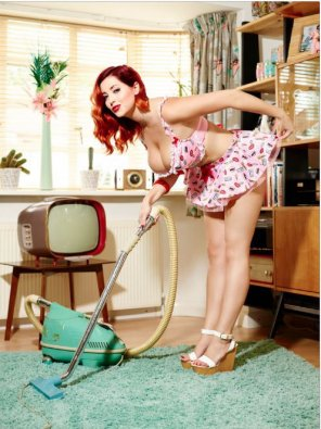 amateur photo Busty Redhead Doing Housework