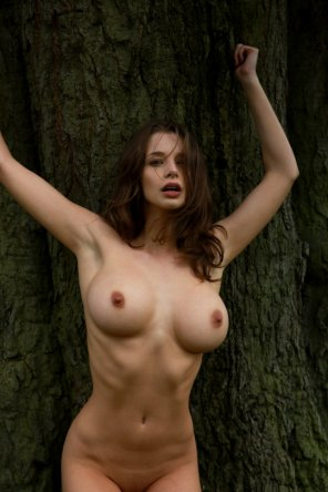 amateur photo Stunning brunette by a tree