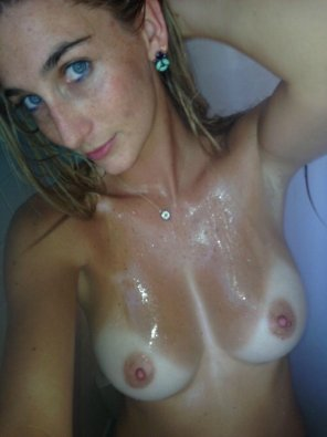 amateur photo Blue eyes, freckles, and tan-lined titties