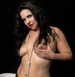 amateur photo Hi Res Asheville burlesque dancer Quiet Hurricane holding breast