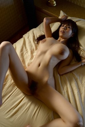 amateur photo Stretched out on her bed