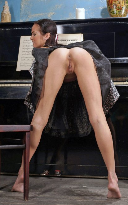 Playing the piano Porn Photo