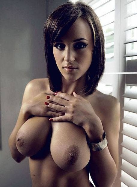 Resting her hands on pillows. Porn Photo