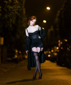 amateur photo Beautiful redhead in stockings under the streetlights