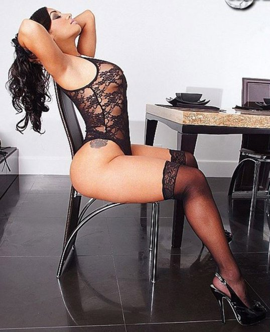 Curvy woman in black stockings Porn Photo