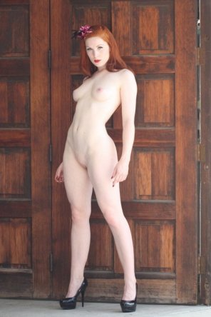 amateur photo Redhead door greeter