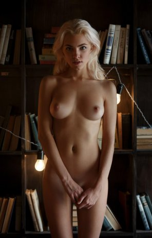 amateur photo Blonde with books