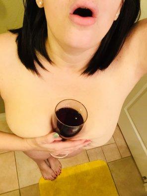 amateur photo Wine looks great against these pale breasts.