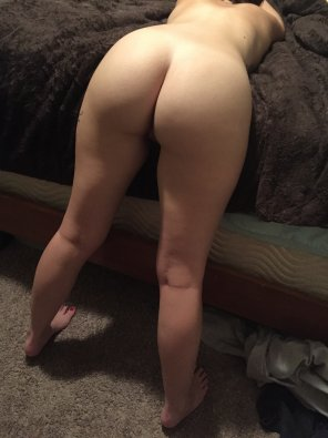 amateur photo Bent over, who wants to hit it from behind ?