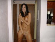 Cute embarrassed girl tries to cover-up her lovely naked body