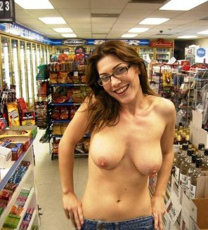 amateur photo Topless in a gas station