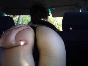 amateur photo proper position on a back seat