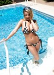 amateur photo Sexy busty blonde by the pool