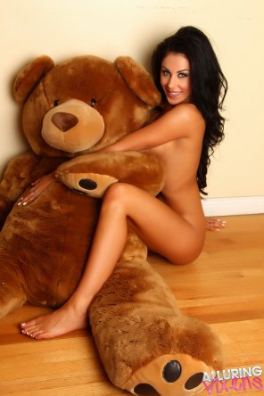 amateur photo Danielle hugging her giant teddy bear
