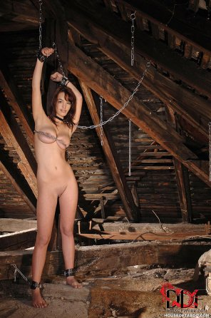 amateur photo Hot woman in chains in the attick