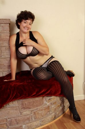 amateur photo Busty woman in striped stockings
