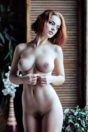 amateur photo Very cute redhead with big boobs.