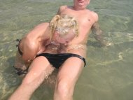 blond sucks cock on a public nude beach