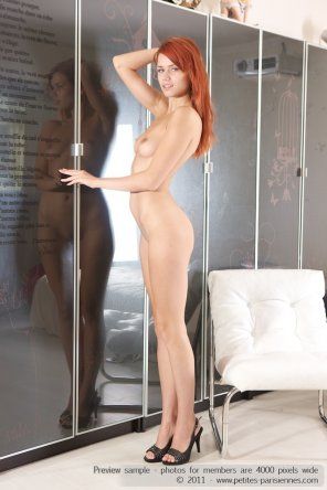 amateur photo Slender redhead with smaller tits