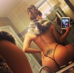 Mirror selfshot with her iPad