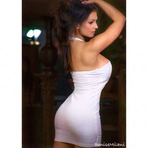 amateur photo Denise Milani in a beautiful form hugging white halter dress