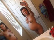 Naked in her bathroom