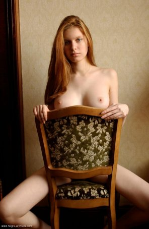 amateur photo Hiding behind her chair