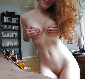 amateur photo Petite bodied redhead.