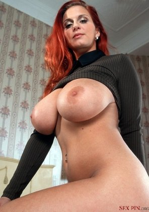 amateur photo Nice looking redhead with a splendid pair of boobs