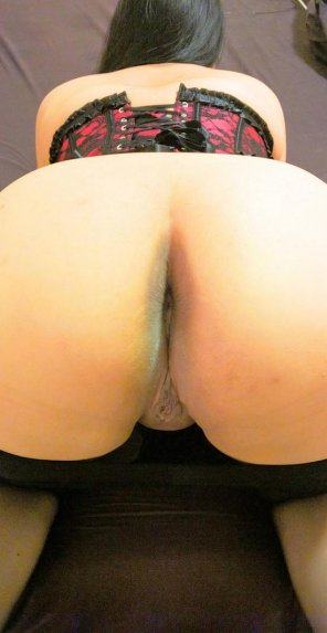 amateur photo Asian rear view with a corsette