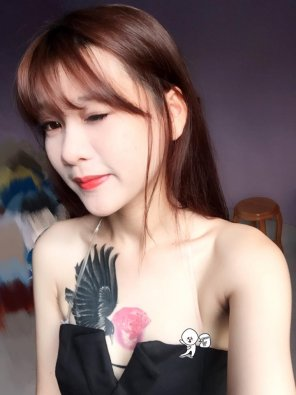 amateur photo Girl with rose tatoos