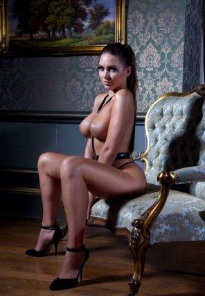 amateur photo Big Tits Brunette in the Decorative Room