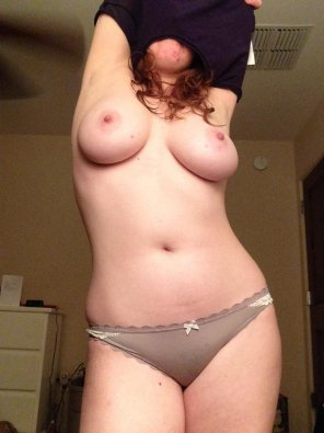 amateur photo Girl With Big Tits Strips Down
