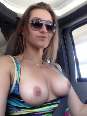 amateur photo Very nice sunglasses, necklace and boobs