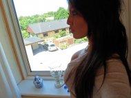 Standing near the window
