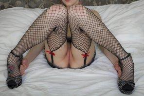 amateur photo Fishnets and red bows
