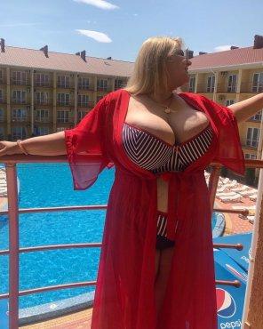 amateur photo Overflowing her bikini top