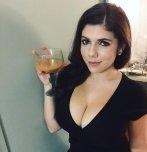 amateur photo Emily raising her glass